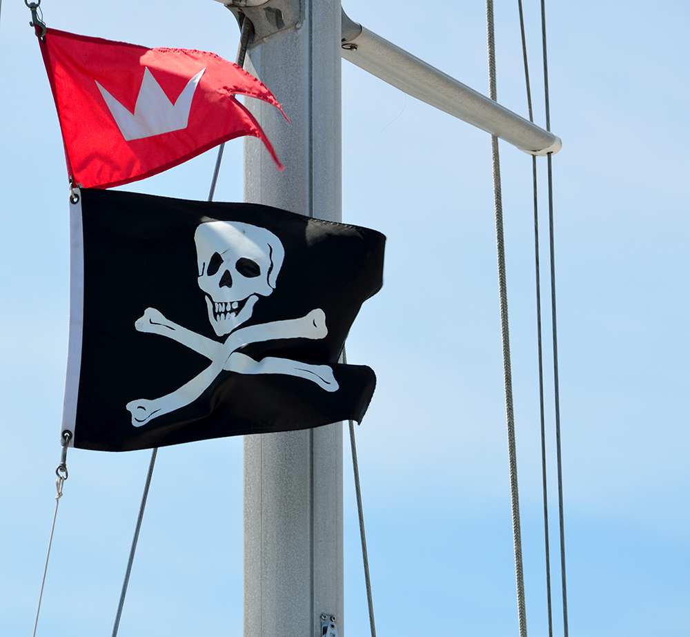 Pirate flag on sailing yacht